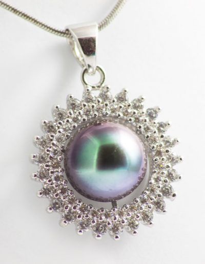 Les pendentifs or blanc 18 cts 9